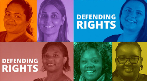 """Six people smile and text """"defending rights"""""""