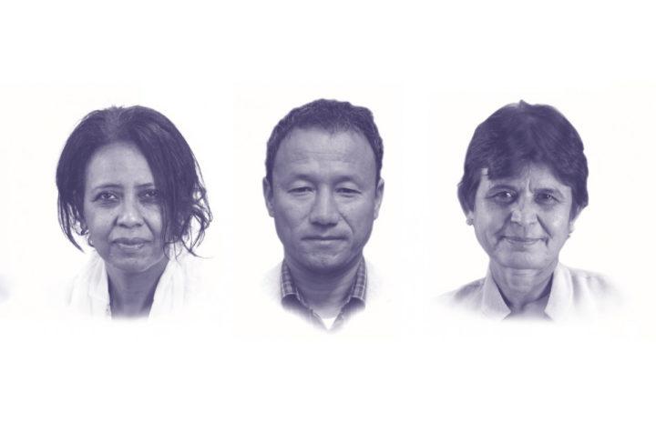 Kolme päätä valkoisella taustalla